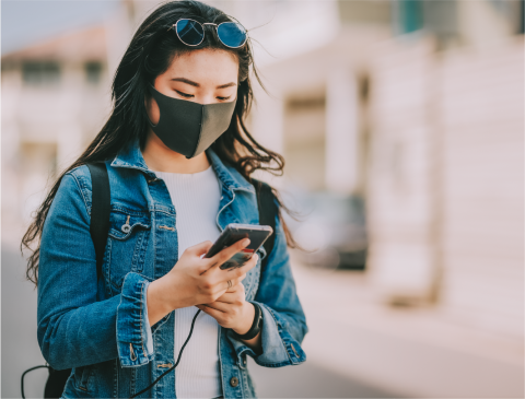 Girl wearing mask on phone